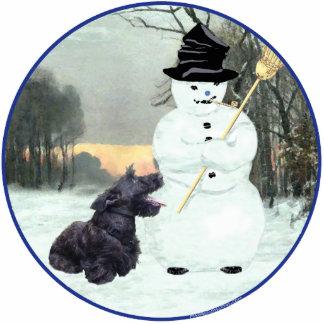 Perro y muñeco de nieve del escocés fotoescultura vertical