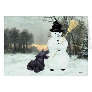 Perro y muñeco de nieve del escocés tarjeta de felicitación