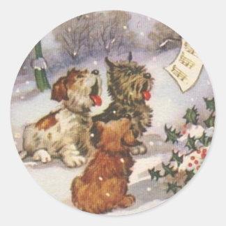 Perros de Caroling en la nieve Pegatina Redonda