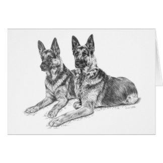 Perros de pastor alemán que dibujan por el cisne d tarjeta