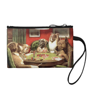 Perros divertidos que juegan el mitón del monedero