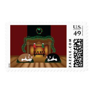 Perros esquimales del día de fiesta por la tarjeta timbres postales