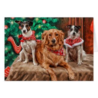 Perros que celebran navidad tarjeta de felicitación