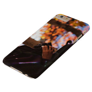 Person holding binoculars outside barely there iPhone 6 plus case