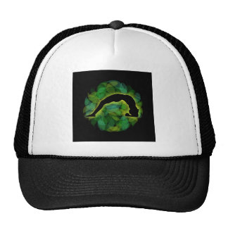Person in a yoga pose on green leaves trucker hat