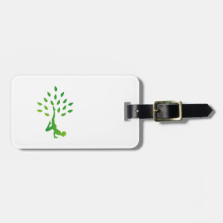 Person in yoga pose forming a healthy tree bag tag