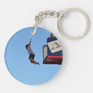 person jumping off of tower fair ride acrylic keychains