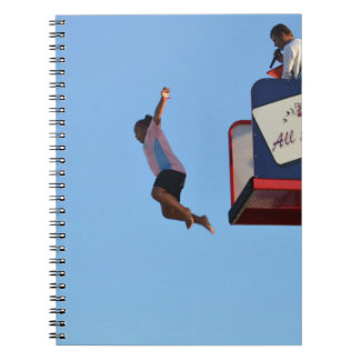 person jumping off of tower fair ride notebook