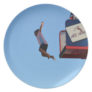 person jumping off of tower fair ride dinner plates