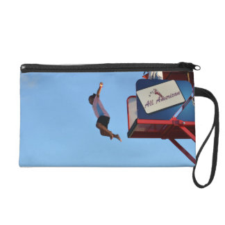 person jumping off of tower fair ride wristlet purse
