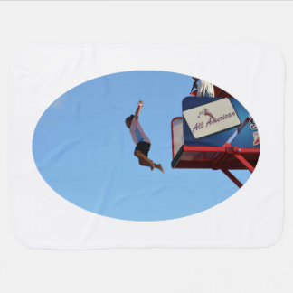 person jumping off of tower fair ride swaddle blanket