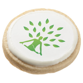 Person meditating under a tree round shortbread cookie