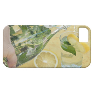Person pouring water (mint-filled) into a glass iPhone SE/5/5s case