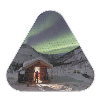 Person stands in doorway of Caribou Bluff cabin 2 Bluetooth Speaker