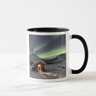 Person stands in doorway of Caribou Bluff cabin 2 Mug