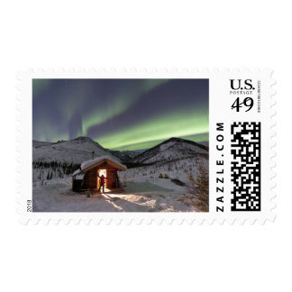 Person stands in doorway of Caribou Bluff cabin 2 Postage