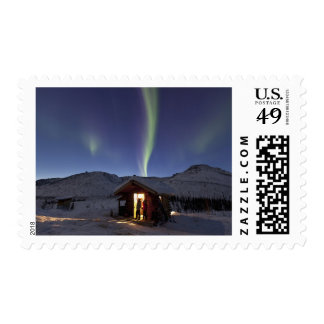 Person stands in doorway of Caribou Bluff cabin 3 Stamp