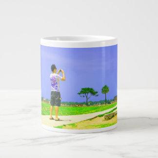 Person taking pic st augustine giant coffee mug