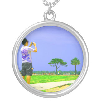 Person taking pic st augustine round pendant necklace