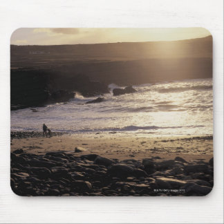 person with child walking on rocky beach mouse pad