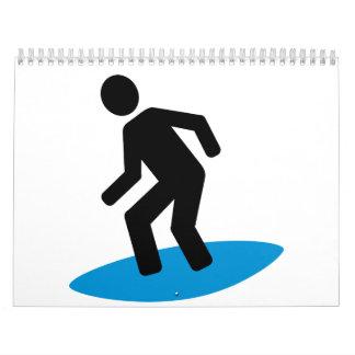 Persona que practica surf calendarios de pared