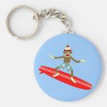 Persona que practica surf del mono del calcetín llavero personalizado