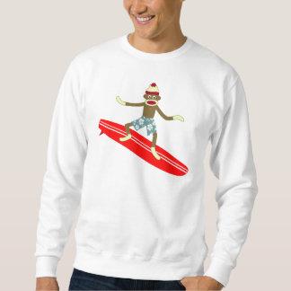 Persona que practica surf del mono del calcetín sudadera