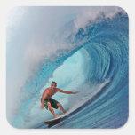 Persona que practica surf que practica surf una pegatinas cuadradases