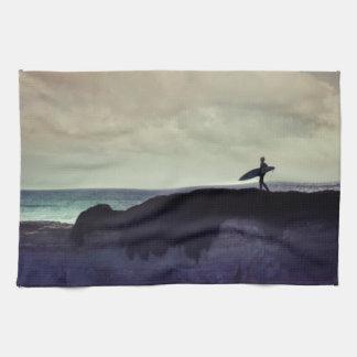 Persona que practica surf toallas de mano