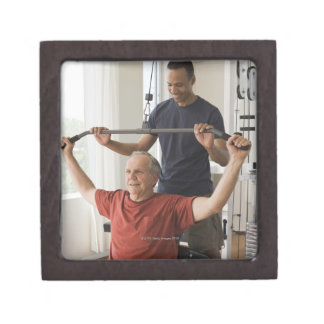Personal trainer with man in home gym gift box