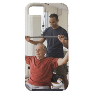Personal trainer with man in home gym iPhone 5 cases