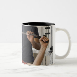 Personal trainer with man in home gym Two-Tone coffee mug
