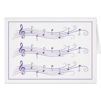 Personales enrollados púrpuras de la música en la  tarjeta pequeña