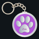 "Personalised dogs name tag paw print keychain<br><div class=""desc"">Beautiful violet and silver dogs paw print customizable personalised letter Z name tag keychain.  Change name to the required pets name.  great gift idea for dog lovers</div>"