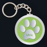 "Personalised dogs name tag paw print keychain<br><div class=""desc"">Beautiful green and silver dogs paw print customizable personalised letter U name tag keychain.  Change name to the required pets name.  great gift idea for dog lovers</div>"