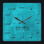 """Personalised Music Notes - Music is Life Square Wall Clock<br><div class=""""desc"""">Personalized music note wall clock.  Each note represents a beat in numerical value.  Add your name to customize the clock and make it unique!  Aqua Blue background.  Music is Life. Custom color request accepted.  Click the contact link below.</div>"""
