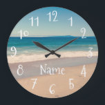 "Personalized Aqua Beach Scene Large Clock<br><div class=""desc"">Tinted photo of a beach scene along Monterrey Bay,  California with a pretty turquoise band and quirky,  cute white numbers and personalized text. Create your own wall clock with a Cali theme. There's a watch version in the shop already.</div>"