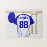"""Personalized Blue and White Baseball Jersey Jigsaw Puzzle<br><div class=""""desc"""">Personalized blue and white baseball jersey hanging in a sports locker room with a baseball cap, baseball bats and ball which is fully customizable with your own name and number. Great gift for any baseball, t-ball or softball player or fan. We welcome custom requests for different color combinations for your...</div>"""