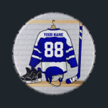 """Personalized Blue and White Ice Hockey Jersey Candy Tin<br><div class=""""desc"""">A personalized ice hockey jersey in blue and white hanging in a sports locker room with a helmet, ice skates and an ice hockey stick. The jersey can be fully customized with the number and name of your choice to make a great gift for the ice hockey fan, ice hockey...</div>"""