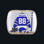 """Personalized Blue and White Ice Hockey Jersey Jelly Belly Candy Tin<br><div class=""""desc"""">A personalized ice hockey jersey in blue and white hanging in a sports locker room with a helmet, ice skates and an ice hockey stick. The jersey can be fully customized with the number and name of your choice to make a great gift for the ice hockey fan, ice hockey...</div>"""