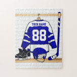 "Personalized Blue and White Ice Hockey Jersey Jigsaw Puzzle<br><div class=""desc"">A personalized ice hockey jersey in blue and white hanging in a sports locker room with a helmet, ice skates and an ice hockey stick. The jersey can be fully customized with the number and name of your choice to make a great gift for the ice hockey fan, ice hockey...</div>"