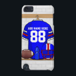 "Personalized Blue White Red Football Jersey iPod Touch (5th Generation) Case<br><div class=""desc"">A personalized American football grid iron jersey in blue with white and red stripes, hanging in a sports changing room with a football helmet, a water bottle and a football. The jersey can be fully personalized with the number and name of your choice to make a great gift for any...</div>"
