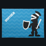"""Personalized Boy Black Knight Blue Chevron Cloth Placemat<br><div class=""""desc"""">Personalized fighting knight children&#39;s place mat. Kids blue cloth chevron place mat with black and white knight holding a sword and shield. Personalize with name in white font. Fun kid friendly graphics. Great personalized gifts for kids who love knights or prince themes.</div>"""