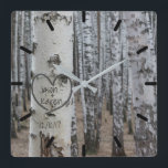 "Personalized Country Rustic Carved Heart Square Wall Clock<br><div class=""desc"">Personalized country rustic art carved heart design on the front features a printed birch bark tree with a carved heart that you can customize by adding your names and underneath it, you can add your wedding date or special date. This would make a unique wedding shower gift or anniversary gift....</div>"
