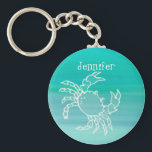 "Personalized Crab in an aquamarine colored ocean Keychain<br><div class=""desc"">A single crab in an aquamarine colored ocean. Personalize with your name,  white letters.</div>"