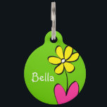 """Personalized Daisy Pet Tag - Green/Pink<br><div class=""""desc"""">This cute daisy pet tag is perfect to attach to that new spring collar. Personalize it with your pet&#39;s name on the front and on the back. Also, the back has a place for your contact information in case your pet gets lost. To change the background colors or font, just...</div>"""