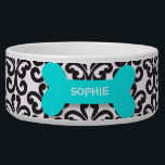 "Personalized damask aqua dog bone pet food bowl<br><div class=""desc"">This ceramic dog food bowl has a stylish black and white damask swirl pattern in the background.  In the middle,  there is a large aquamarine blue bone with an easily customized name of your doggie written in white.</div>"