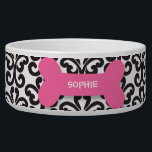 "Personalized damask pink dog bone pet food bowl<br><div class=""desc"">This ceramic dog food bowl has a stylish black and white damask swirl pattern in the background.  In the middle,  there is a large pink bone with an easily customized name of your doggie written in white.</div>"