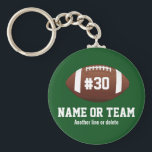 "Personalized Football Design Name, Number, Team Keychain<br><div class=""desc"">This personalized football design features an American football with a jersey number and one or two lines of custom text - player&#39;s name, school name, team name, etc. Perfect for high school, youth or college player or football fans. Show your school spirit and love of football with a customized football...</div>"