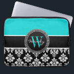 "Personalized Initial Aqua Black Damask Pattern Laptop Sleeve<br><div class=""desc"">This elegant monogrammed design is made up of a black and white damask pattern, a black stripe and a decorative circle tag. Personalize with your name and monogram or initial in gorgeous script fonts. Be stylish and girly all at the same time. Design by Elke Clarke&#169;. More styles and colors...</div>"